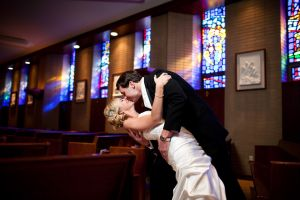Bride and Groom dip kiss at Mary our Queen Omaha Nebraska